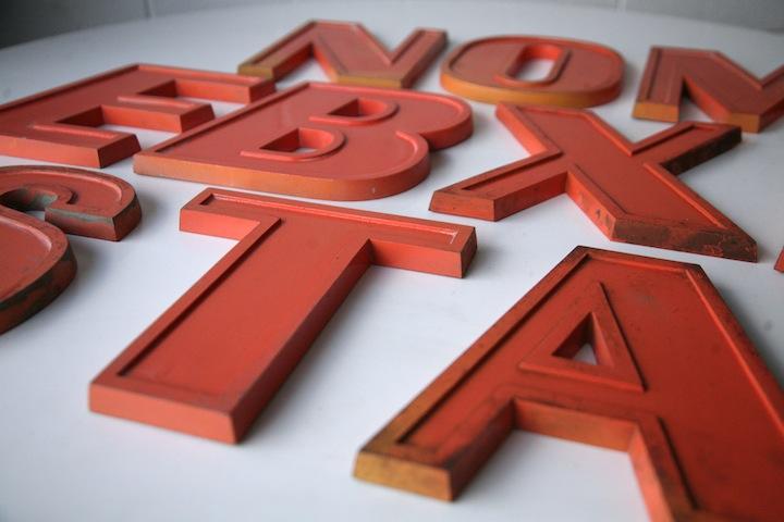 Vintage Orange Metal Shop Letters Doric Font Cream And